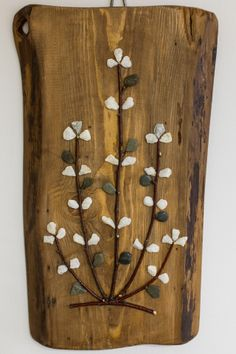 Feng-Shui  Flower made out of twigs and natural pebbles glued on a pine board in an arrangement that relaxes the eye and brightens the atmosphere.