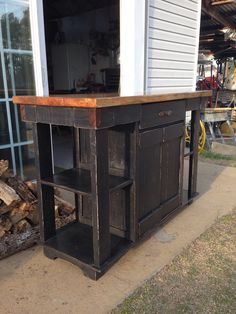 Made from a mixture of new lumber and reclaimed pallet lumber, this primitive kitchen island features a spacious pass through drawer and a