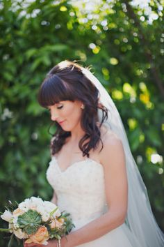 Bangs and curls: http://www.stylemepretty.com/little-black-book-blog/2014/12/01/rustic-el-chorro-lodge-wedding/ | Photography: Pinkerton - http://pinkertonphoto.com/