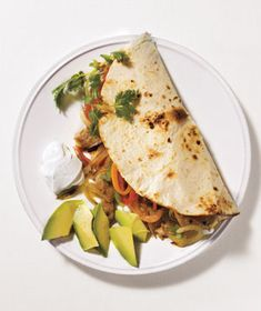 Pork Fajitas | Cumin-spiced pork tenderloin mingles with sautéed peppers and onions in this classic crowd-pleasing meal.