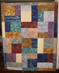 Lap size quilt I made for the front of the piece of African fabric.  This is the pattern called Turning Twenty.