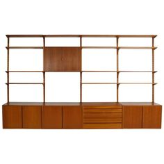Large 1960s Poul Cadovius Teak Wall Unit 'Royal Shelf System' Cado, Denmark | See more antique and modern Bookcases at https://www.1stdibs.com/furniture/storage-case-pieces/bookcases