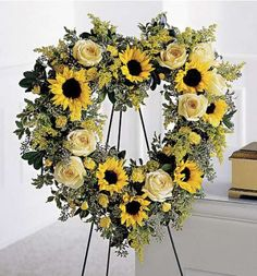 Looking for flower hearts or a funeral flower heart? Honor those you lost with a beautiful sympathy floral heart arrangement. We specialize in creating traditional flower heart arrangements for funeral, memorial, church services and the home. Arrangements Funéraires, Funeral Floral Arrangements, Funeral Sprays, Casket Sprays, Memorial Flowers, Cemetery Flowers, Sympathy Flowers, Funeral Flowers, Yellow Roses