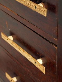 Crafty Chic Knobs ~ Vintage Rulers Positioned atop dowel segments, these rulers offer immeasurable function.