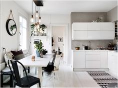 Loving those kitchen lights from this lovely Swedish home!