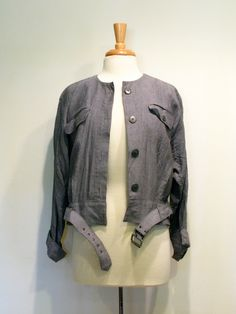 Vintage 1980s Gray Chambray Belted Cropped Jacket. via Etsy.