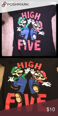 Juniors Large tight fit Mario Bros T shirt Juniors large Mario Brothers T shirt. Looks brand new and black is not faded. Only worn once. Tight fitted shirt. Could be considered a medium Tops Tees - Short Sleeve