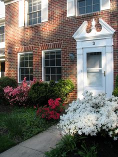 May Chapel Village townhouse with 4 bedrooms, updated kitchen, replacement windows, lower level family room w/fireplace, patio  deck, backs to woods