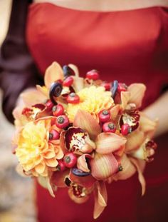 Berry, dahlia and orchid make a wonderful #fall #wedding #bouquet