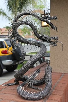2 Headed Dragon 10 feet long. conceived and built by Artist Sculptor Greg Coffelt.
