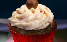 Chocolate malt cupcakes with cherry frosting