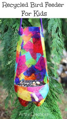 Use 2 liter soda bottles to create these fun and pretty Recycled Bird Feeders For Kids! A great boredom buster that's cheap too.