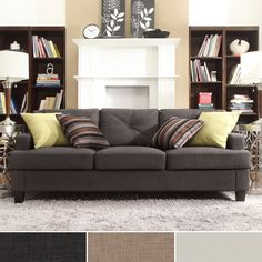 Make your guests feel at home with a sofa that perfectly blends comfort with style. The sloping arms, T-shaped seat cushions and espresso-stained feet are the hallmarks of the light brown tufted Cameron sofa.