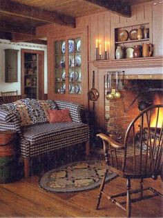 Windsor chair/ wall color..shelves above fireplace filled with crocks...