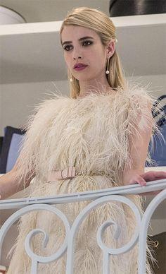 Chanel Oberlin wearing a feather dress: http://www.pradux.com/tv/scream-queens/chanel-oberlin