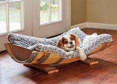 This chic dog bed made out of a wine barrel is the perfect way to express your love for your dog AND your wine.