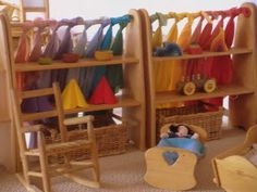 rainbow silks playstands  (used as shelves for toys), rocking chair, doll cradles
