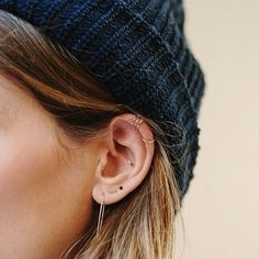"LOVE. Subtle and pretty.. from far away, her ears look bare. Makes me feel better about wanting multiple piercings as a ""grown-up."" I want her little inner earring for my double lower cartilage piercing!"