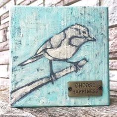 "Day 170: A bird on a small block of wood. I added the metal ""Choose Happiness"" tag on the front."