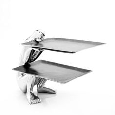 Carefully formed of durable, lightweight aluminum with a scratch-resistant finish, Carrol Boyes' platter features a sculptural crouching figure that artfully displays food and accessories. Carroll Boyes, Hallandale Beach, Sculpture, Platter, Accessories, Design, Serveware, Birthday Wishes, South Africa