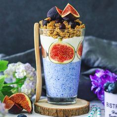 Healthy blue breakfast cup. Just mixed yogurt with natural blue matcha powderdecorated with vanilla yogurt figs and coconut granola/muesli