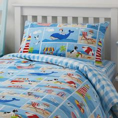 The adventures of Patch the dog continue as he and his friends enjoy a fun filled day at the seaside. A co-ordinating striking blue gingham check features on the reverse of this bedding set, that has been produced using a blend of easy care poly cotto