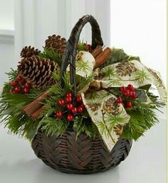 Christmas Bouquet in Brown Basket Christmas Flower Arrangements, Christmas Greenery, Christmas Baskets, Christmas Flowers, Noel Christmas, Christmas Centerpieces, Rustic Christmas, Xmas Decorations, Christmas Projects
