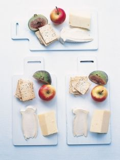 Make a single-serve cheese board for each of your guests. That way there is no reaching across the table or waiting for the cheese to be passed to you; everyone can nibble at their leisure. Place a selection of cheeses, a stack of crackers or lavash and fruit, such as figs and miniature apples, on small bread boards. And don't forget the cheese knives.