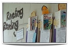 students decorate face and hands holding recreation of their favorrite book - cover on right side, summary on left for FACE of a reader display