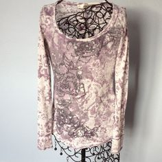 "Vanity Light purple top, embellished Lightweight and thin pullover long sleeve top. Has rhinestone look embellishment on front and small gathered seam on back below neckline. Gently worn. Light purple color. Length is 23"". Across front is 29"". Vanity Tops Tees - Long Sleeve"