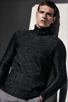 Add a metallic impact with the premium mock neck sweater from Calvin Klein.