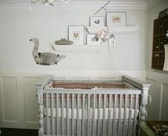 A baby nursery decorated with vintage finds, antique features and a unique homemade mangle cloth and lace crib bedding set. A baby nursery decorated with vintage finds is best accomplished by purchasing one special piece at a time.  The nursery featured in the photos that follow