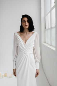 NIKKI // This new BESPOKE gown features long georgette sleeves and a wrap style bodice that opens up into an elegant split in the skirt. Make your appointment at a KWH boutique today. Photographer - Kas Richards // Follow us @kwhbridal