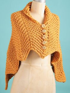 Free Knitting Pattern for 2 Row Repeat Easy Cedar Wrap - This buttoned shawl is knit with a 2 row ripple stitch. Quick knit in super bulky yarn. Designed by Susan B. Anderson. Rated very easy by most Ravelrers