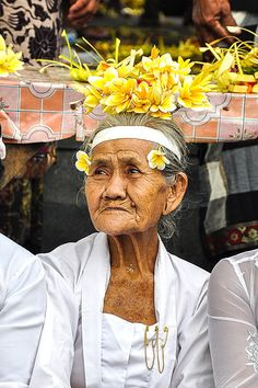 A lovely old lady participatinhg in a religious festival in Bali.