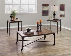 Contemporary 3 pc Table Set in Brown by Ashley Home Furniture. Includes: 2 end tables + 1 coffee table. Scrolling black color finished metal adorned with brown top & wheels on bottom. Parks Furniture, Coaster Furniture, Furniture Companies, Living Room Furniture, Home Furniture, Furniture Ideas, Office Furniture, 3 Piece Coffee Table Set, Coffee Table Images