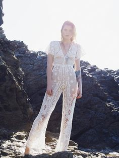 white crochet jumpsuit by Spell, with Celeste Twikler crystal necklace. Celeste Twikler Illustration and hand made Jewellery