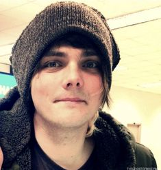 he looks like a little kid whose mom put a hat on him to keep him warm as he goes outside to play in the snow.