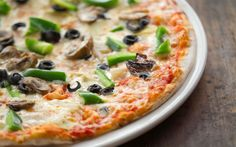 A pizza topped with pepper, mushrroms and olives at Al Firenze in Durban, South Africa