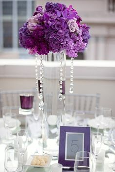 purple glass centerpiece by jcohren. Cute! Too tall for me, but I also love the table numbers!