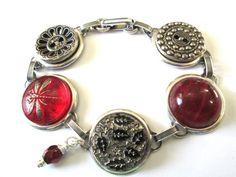 Antique button bracelet. Rare glass button at center, glass DRAGONFLY button