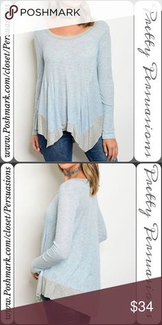 """NWT Blue & Gray Trim Long Sleeve Jersey Top NWT Blue & Gray Trim Long Sleeve Jersey Top  Available in S, M, L Measurements taken from a small  Length: 29"""" Bust: 40"""" Waist: 44""""  Made in the USA Rayon Blend   Features  • long sleeves • rounded neckline  • angled hem  • soft, jersey material   Bundle discounts available  No pp or trades  Item # 1/1011230340BGT asymmetrical angled color block trim long sleeve Pretty Persuasions Tops Tees - Long Sleeve"""