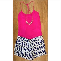 Getting ready for beach trips this summer? These seahorse print shorts absolutely HAVE to be in your suitcase! Paired with one of our fave hot pink tops! Shorts $45.99 Top $27.99 Necklace $15.99