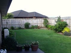 Photo of the area at client's property to be re-designed, showing existing plants etc