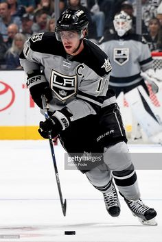Anze Kopitar #11 of the Los Angeles Kings skates with the puck during the game against the Calgary Flames on November 5, 2016 at Staples Center in Los Angeles, California. #LAKings #WeAreAllKings