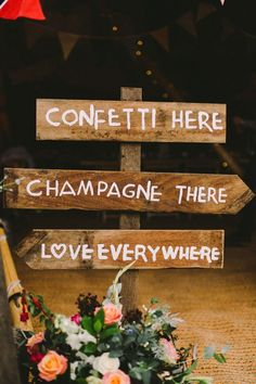 use a sweetly handwritten sign (above) to direct guests where to go, but also surround it with gorgeous flowers | see more camp #wedding details here: http://www.mywedding.com/articles/camp-wedding-details-and-ideas/