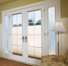 This white French door set from Pella's Designer series shows two available options - decorative grids and built-in blinds that raise up from the bottom.  You get privacy but still plenty of light.  The art glass sidelights bring even more light into this room.  For #Pella windows and#PellaFrenchDoors in the Minneapolis MN area, visit us at http://www.replacementwindowsmpls.com