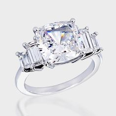 4.5 Ct. Cushion Cut   Fancy Solitaire  14K Ring. This beautiful cubic zirconia ring features a 4.5 carat cushion-cut center with two baguettes set on each side. An approximate 5.34 total carat weight. This high quality cubic zirconia ring is set in solid 14K white gold, and is available in 14K yellow gold via Special Order. Cubic zirconia weights refer to equivalent diamond carat size.
