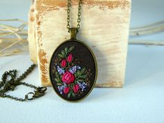 Red flower necklace. Hand embroidered by EmbroideredJewerly