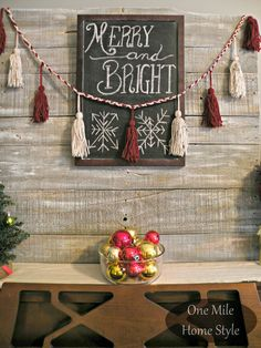 Keep your decor simple with a Merry & Bright Christmas chalkboard message and DIY Yarn Tassel Garland | One Mile Home Style